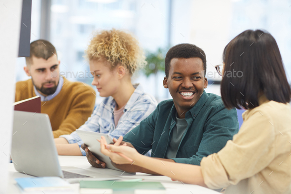 Cheerful Young People Studying in Library - Stock Photo - Images