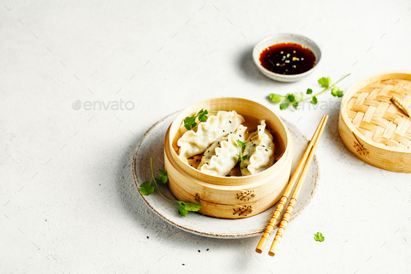 Vegetables dumplings Dim Sum in bamboo steamer on a grey background with copy space. Asian cuisine - Stock Photo - Images