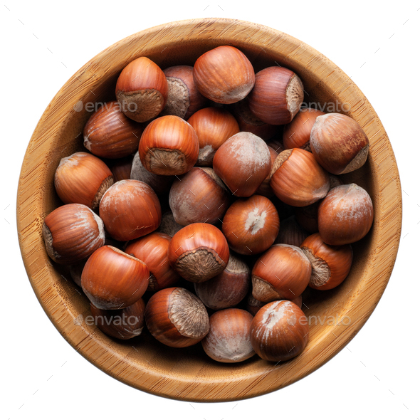 Unpeeled hazelnuts in a round wooden bowl - Stock Photo - Images