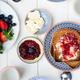Tasty Family Breakfast with Toasts, Porridge, Berries - PhotoDune Item for Sale