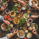 Flat-lay of Turkish family eating traditional Middle Eastern breakfast - PhotoDune Item for Sale