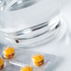 Medicine pills in blister with glass of water - PhotoDune Item for Sale