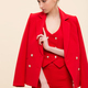 Attractive fashion model in red tuxedo suit posing in studio with jacket on her shoulders - PhotoDune Item for Sale