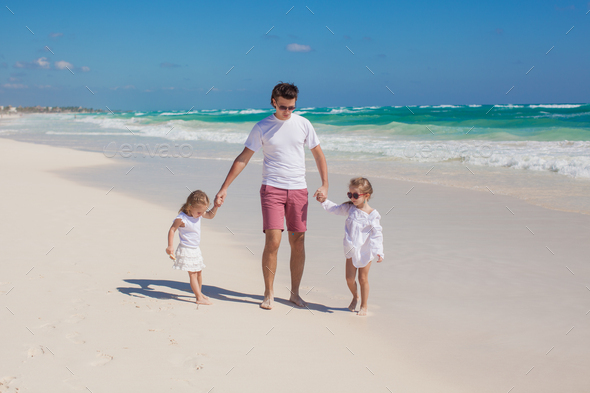 Happy father and his adorable little daughters on sunny day - Stock Photo - Images