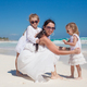 Portrait of young beautiful mother and her adorable little daughters at tropical beach - PhotoDune Item for Sale
