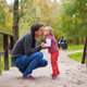 Father kissing his little daughter in a park - PhotoDune Item for Sale