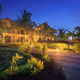 Amazing hotel with lighted paths in flowers garden in summer night - PhotoDune Item for Sale