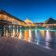 Beautiful wooden restaurant on the water in summer night - PhotoDune Item for Sale