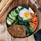 Healthy breakfast or lunch with fried egg, avocado, toasts, beans and fresh spinach - PhotoDune Item for Sale