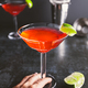 Red cocktail with lime in Martini glass on a table. - PhotoDune Item for Sale