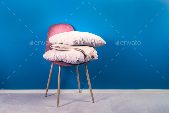 Modern Pink Velour Chair with Beige Cushions and Throw - Stock Photo - Images