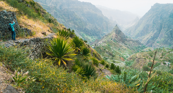 Photographer takes a picture of amazing lush Xo-Xo valley. Rugged Lombo de Pico in the middle. Santo - Stock Photo - Images