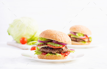 Big sandwich - hamburger burger with beef, avocado, tomato and red onions