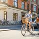 Cute girl on bike pulling friend on skateboard - PhotoDune Item for Sale