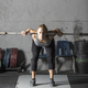 Strong young woman warming up in preparation for heavy lifting in gym, - PhotoDune Item for Sale