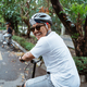 Asian youths look back and smiling when riding bicycles on the road - PhotoDune Item for Sale