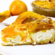Pie with curd and persimmons in plate on napkin silicone and board - PhotoDune Item for Sale