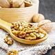 Walnuts in spoon on dark board - PhotoDune Item for Sale