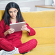 Persian woman at home using digital tablet - PhotoDune Item for Sale