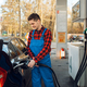 Male worker in uniform fuels car on gas station - PhotoDune Item for Sale