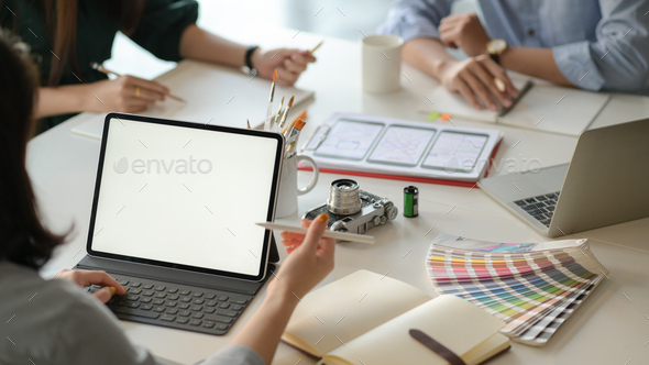 Graphic designer team uses laptops to design new projects for customers. - Stock Photo - Images