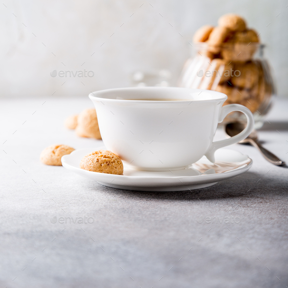 White cup of coffee with amaretti cookies - Stock Photo - Images