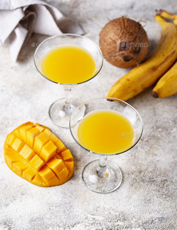 Tropical cocktail with mango on light background - Stock Photo - Images