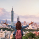 Young woman traveler looking beautiful cityscape at sunset in Taipei, Travel lifestyle concept - PhotoDune Item for Sale