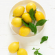Fresh lemons with leaves, vitamin c concept, top view - PhotoDune Item for Sale