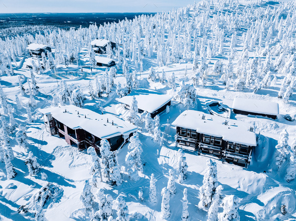 Aerial View Of Wooden Log Cabin And Snow Covered Trees In Winter Finland Lapland Stock Photo By Nblxer