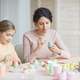 Young Mother Painting Easter Eggs at Home - PhotoDune Item for Sale