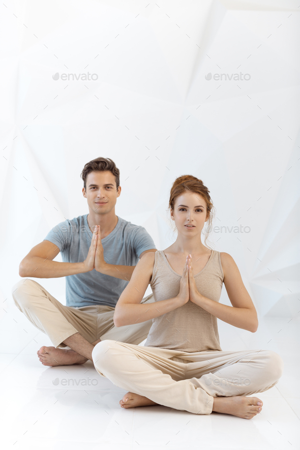 Young couple in yoga pose - Stock Photo - Images