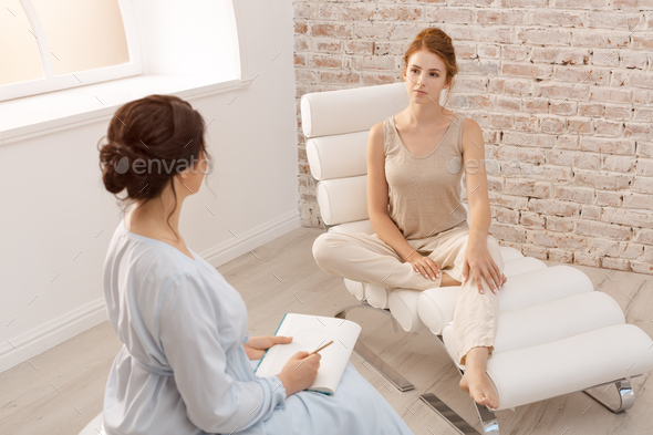 Psychologist having session with her patient in office - Stock Photo - Images