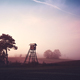 Rural landscape with silhouette of hunting tower on a field at sunrise. - PhotoDune Item for Sale