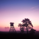 Rural landscape with silhouette of hunting tower at sunrise - PhotoDune Item for Sale