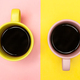 Flat lay of a two coffee cups with pink and yellow - PhotoDune Item for Sale