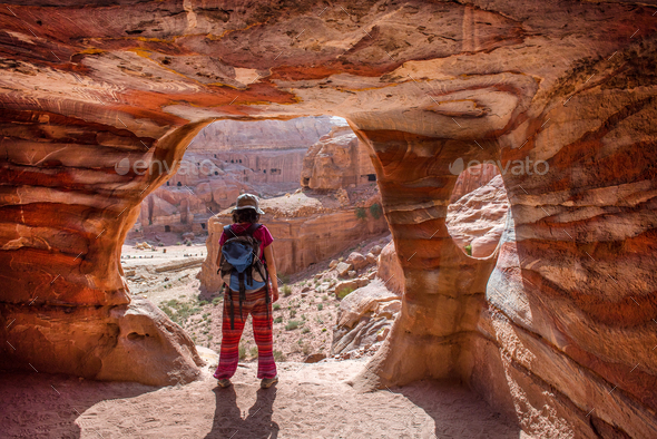 Traveler Woman Posing at the Entrance of a Tomb in Petra, Jordan - Stock Photo - Images