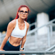 Portrait of attractive red head woman, caucasian woman working out and wearing sportswear - PhotoDune Item for Sale