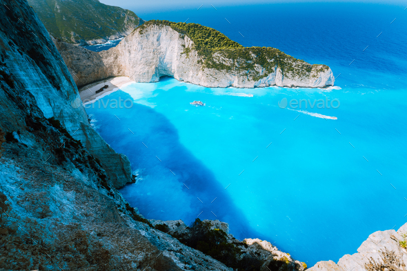 Navagio beach or Shipwreck bay with turquoise water and pebble white beach. Famous landmark location - Stock Photo - Images