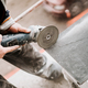 Construction site details - industrial tool, worker with angle grinder cutting marble stone - PhotoDune Item for Sale