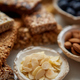 Close up of Almond petals. With various energy nutrition bars in background - PhotoDune Item for Sale