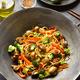 Udon stir-fry noodles with vegetables in wok - PhotoDune Item for Sale