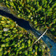 Aerial view of fast river through green pine forest in Finland - PhotoDune Item for Sale