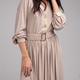 Sensual woman in casual beige dress. Studio shot - PhotoDune Item for Sale
