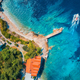 Aerial view of sea coast with clear blue water and boat - PhotoDune Item for Sale