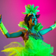 Beautiful young woman in carnival and masquerade costume on gradient studio background in neon light - PhotoDune Item for Sale
