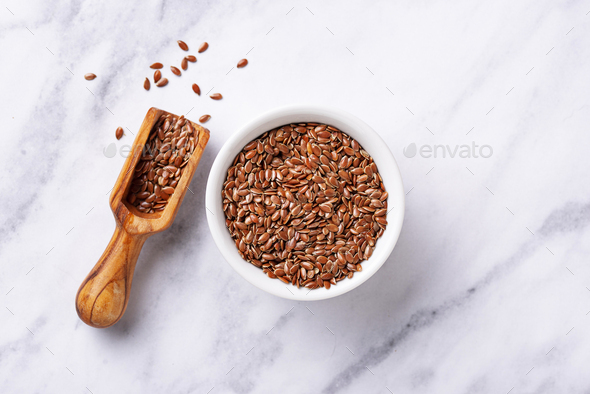 Flax seeds in white bowl - Stock Photo - Images