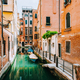 Venice Italy. Canal with old typical orange facade houses, patio and windows - PhotoDune Item for Sale