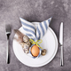 Eastre Table Setting on Stone Background. - PhotoDune Item for Sale