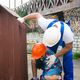 Father and son are building a doghouse together. Father is teaching his son to use the electric - PhotoDune Item for Sale
